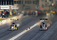 Jul. 19, 2014; Morrison, CO, USA; NHRA top fuel driver Bob Vandergriff Jr (right) races alongside Tony Schumacher during qualifying for the Mile High Nationals at Bandimere Speedway. Mandatory Credit: Mark J. Rebilas-