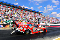 Sept. 15, 2012; Concord, NC, USA: NHRA funny car driver Jim Head (near lane) races alongside John Force during qualifying for the O'Reilly Auto Parts Nationals at zMax Dragway. Mandatory Credit: Mark J. Rebilas-