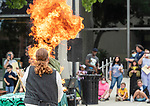 WATERBURY, CT 073021JS05 Daniel GreenWolf entertains the crowd during his fire-breathing magic show outside the Silas Bronson Library as part of Harry Potter Day festivities in downtown Waterbury on Friday. <br />  Jim Shannon Republican American