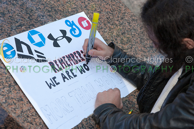A man creates a protest sign in Zuccotti Park using a magic marker during the Occupy Wall Street demonstration in New York City, New York.