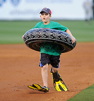 A young fan of the Greenville Drive participates in a between-innings stunt during a game against the West Virginia Power on Tuesday, April 16, 2013, at Fluor Field at the West End in Greenville, South Carolina. West Virginia won, 8-3. (Tom Priddy/Four Seam Images)