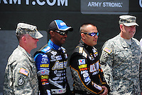 Jun. 16, 2012; Bristol, TN, USA: NHRA top fuel dragster driver Antron Brown (left) and Tony Schumacher with  Army soldiers during qualifying for the Thunder Valley Nationals at Bristol Dragway. Mandatory Credit: Mark J. Rebilas-