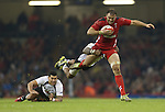 Fiji scrum half Nikola Matawalu makes a flying tackle on Wales centre Jamie Roberts.<br /> Dove Men Series 2014<br /> Wales v Fiji<br /> Millennium Stadium<br /> 15.11.14<br /> ©Steve Pope-SPORTINGWALES