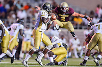 Texas State linebacker David Mayo (3) jumps over running back Aaron Lagrone (4) to pass rush quarterback Benjamin Anderson (11) during second half of NCAA Football game, Saturday, August 30, 2014 in San Marcos, Tex. Texas State defeated Arkansas Pine-Bluff 65-0 to win the season opener. (Mo Khursheed/TFV Media via AP Images)