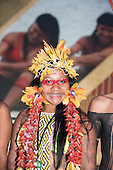 A Karaja Brazilian indigenous girl with mulitcoloured tooth braces smiles during the International Indigenous Games, in the city of Palmas, Tocantins State, Brazil. Photo © Sue Cunningham, pictures@scphotographic.com 27th October 2015