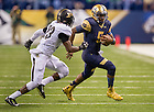 Sept 13, 2014; Quarterback Everett Golson runs with the ball against Purdue in the Shamrock Series football game in Indianapolis. (Photo by Barbara Johnston/University of Notre Dame)