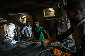 Workers offload raw hide at a processing unit of a tannery in Baantala, the outskirts of Kolkata, West Bengal, India.