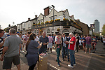 Supporters drinking outside the Princess Royal pub before Brentford hosted Leeds United in an EFL Championship match at Griffin Park. Formed in 1889, Brentford have played their home games at Griffin Park since 1904, but are moving to a new purpose-built stadium nearby. The home team won this match by 2-0 watched by a crowd of 11,580.