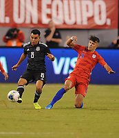 EAST RUTHERFORD, NJ - SEPTEMBER 7: Carlos Rodriguez #8 of Mexico battles for the ball with Alfredo Morales #15 of the United States during a game between Mexico and USMNT at MetLife Stadium on September 6, 2019 in East Rutherford, New Jersey.
