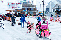 DeeDee Jonrowe runs down Front Street on the way to the finish line in Nome  during the 2017 Iditarod on Friday March 17, 2017.<br /> <br /> Photo by Jeff Schultz/SchultzPhoto.com  (C) 2017  ALL RIGHTS RESERVED