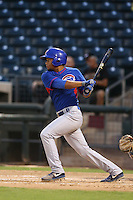 Charcer Burks #24 of the AZL Cubs bats against the AZL Rangers at Surprise Stadium on July 6, 2014 in Surprise, Arizona. AZL Rangers defeated the AZL Cubs, 7-5. (Larry Goren/Four Seam Images)