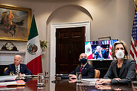 President Andrés Manuel López Obrador of Mexico is seen on a TV screen during a virtual bilateral meeting with President Joe Biden in the Roosevelt Room of the White House in Washington on March 1st, 2021. <br /> Credit: Anna Moneymaker / Pool via CNP /MediaPunch