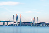The rising sun lights the tops of the towers of the Governor Mario M. Cuomo Bridge just after sunrise.