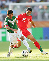 Zinha of Mexico turns the ball away from Arash Borhani of Iran. Mexico defeated Iran 3-1 during a World Cup Group D match at Franken-Stadion, Nuremberg, Germany on Sunday June 11, 2006.
