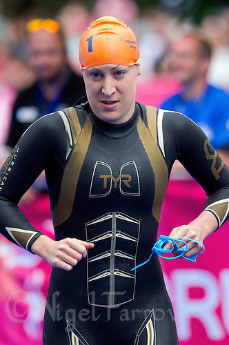 31 MAY 2014 - LONDON, GBR - Jodie Stimpson (GBR) (ENG) of Great Britain and England runs onto the pontoon for the start of the women's 2014 ITU World Triathlon Series round in Hyde Park, London, Great Britain (PHOTO COPYRIGHT © 2014 NIGEL FARROW, ALL RIGHTS RESERVED)