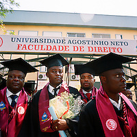 Recently graduated students, dressed in gowns and motar boards, gather outside the Agostinho Neto University's law faculty during their graduation ceremony.