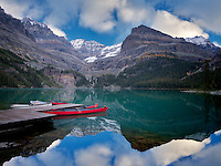 Lake O'hara with red canoes. Yoho National Park, Opabin Plateau, British Columbia, Canada