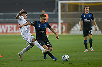 SAN JOSE, CA - SEPTEMBER 13: Tommy Thompson #22 of the San Jose Earthquakes dribbles the ball past Joe Corona #15 of the L.A. Galaxy during a game between Los Angeles Galaxy and San Jose Earthquakes at Earthquakes Stadium on September 13, 2020 in San Jose, California.