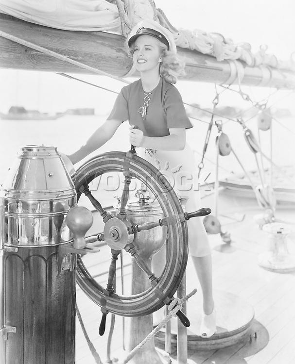 Portrait of woman steering boat
