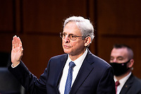 UNITED STATES - FEBRUARY 22: Merrick Garland, center, nominee to be Attorney General, is sworn in for his confirmation hearing in the Senate Judicary Committee on Monday, Feb. 22, 2021. <br /> Credit: Bill Clark / Pool via CNP /MediaPunch