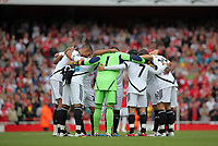Pictured: Swansea players huddle before the start of the game. Saturday 10 September 2011<br /> Re: Premiership Arsenal v Swansea City FC at the Emirates Stadium, London.