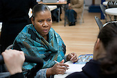 Local residents speak to an A2Dominion Housing Advice and Support worker at a regular Monday afternoon drop-in session at the Beethoven Centre, Queen's Park.