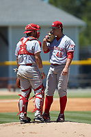 Greeneville Reds catcher Hunter Oliver (28) has a chat on the mound with starting pitcher Jacob Heatherly (48) during the game against the Burlington Royals at Burlington Athletic Stadium on July 8, 2018 in Burlington, North Carolina. The Royals defeated the Reds 4-2.  (Brian Westerholt/Four Seam Images)