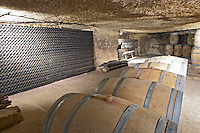 Oak barrel aging and fermentation cellar. Bottles aging in the cellar. An old quarry. Chateau Clos Fourtet, Saint Emilion, Bordeaux, France
