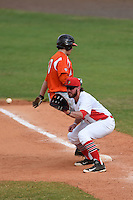 Illinois State Redbirds Mason Snyder (7) waits for a throw as Matt Smith (10) gets back to the bag during a game against the Bowling Green Falcons on March 11, 2015 at Chain of Lakes Stadium in Winter Haven, Florida.  Illinois State defeated Bowling Green 8-7.  (Mike Janes/Four Seam Images)