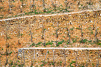 Terraced vineyard with walls made in pattern with big stones in the Les Murets vineyard. The Hermitage vineyards on the hill behind the city Tain-l'Hermitage, on the steep sloping hill, stone terraced. Sometimes spelled Ermitage. Tain l'Hermitage, Drome, Drôme, France, Europe
