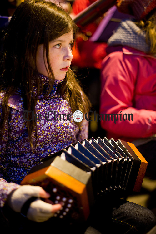 A pupil of Ennis National School performing at the switching on of the Christmas lights in the Market, Ennis. Photograph by John Kelly.