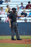 Umpire Britton Kennerly works the plate during the Southern Collegiate Baseball League game between the Concord A's and the Mooresville Spinners at Moor Park on July 31, 2020 in Mooresville, NC. The Spinners defeated the Athletics 6-3 in a game called after 6 innings due to rain. (Brian Westerholt/Four Seam Images)