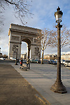 A lamp post is seen in the foreground looking back to a view of the Place Charles De Gaulle and the  Arch De Triumph in Paris France.