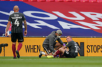 Nicky Adams of Northampton Town receives treatment before having to leave the field during the Sky Bet League 2 PLAY-OFF Final match between Exeter City and Northampton Town at Wembley Stadium, London, England on 29 June 2020. Photo by Andy Rowland.