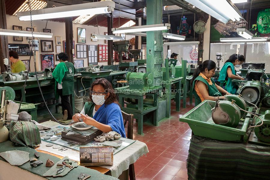 Antigua, Guatemala.  Jade Factory Workshop.  Workers Carving and Polishing Jade.