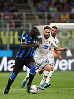 Calcio, Serie A: Inter Milano - Lecce, Giuseppe Meazza stadium, September 26 agosto 2019.<br /> Inter's Romelu Lukaku (l) in action with Lecce's Zan Majer (r) during the Italian Serie A football match between Inter and Lecce at Giuseppe Meazza (San Siro) stadium, September August 26,, 2019.<br /> UPDATE IMAGES PRESS/Isabella Bonotto