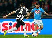 Calcio, Serie A: Napoli vs Juventus. Napoli, stadio San Paolo, 30 marzo 2014. <br /> Napoli forward Lorenzo Insigne, right, is challenged by Juventus defender Martin Caceres, of Uruguay, during the Italian Serie A football match between Napoli and Juventus at Naples' San Paolo stadium, 30 March 2014.<br /> UPDATE IMAGES PRESS/Isabella Bonotto