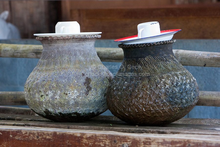 """Myanmar, Burma.  Water for Passers-by in the """"Five-Day"""" Market,  Inle Lake, Shan State."""