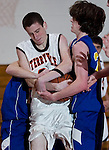 PLYMOUTH, CT--03 January 08--010308TJ10 - Terryville's Eric Gagner (24), center, struggles for the ball with Housatonic players Josh Allyn (15), left, and Ales Dunleavy (24) during Terryville High School's 68-30 victory over Housatonic Valley Regional High School on Thursday, January 3, 2008. T.J. Kirkpatrick/Republican-American