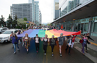 Supporters and members of Alaska's LGBT community take to the streets of Anchorage during Alaska PrideFest's 2015 Equality Parade.