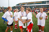 Yael Averbuch (18) and Rebecca Moros (38) of the Western New York Flash hold the WPS Championship trophy. The Western New York Flash defeated the Philadelphia Independence 5-4 in a penalty kick shootout after playing to a 1-1 tie during the Women's Professional Soccer (WPS) Championship presented by Citi at Sahlen's Stadium in Rochester NY, on August 27, 2011.