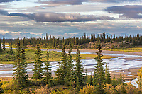 Ahnewetut Creek flows through the Great Sand Dunes in the Kobuk Valley National Park, Arctic, Alaska, Baird mountains in the distance.