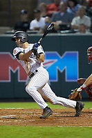 Max Burt (17) of the Pulaski Yankees follows through on his swing against the Greeneville Reds at Calfee Park on June 23, 2018 in Pulaski, Virginia. The Reds defeated the Yankees 6-5.  (Brian Westerholt/Four Seam Images)
