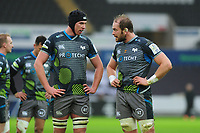 Adam Beard speaks with Alun Wyn Jones of Ospreys during the Heineken Champions Cup Round 5 match between the Ospreys and Saracens at the Liberty Stadium in Swansea, Wales, UK. Saturday January 11 2020.