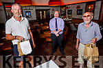 Jim O'Connor and Harold Behan collecting their takeaway meal from Richard O'Mahoney at the Grand Hotel on Saturday.