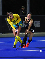 Karri Somerville of Australia and Kelsey Smith of New Zealand (right) during the Sentinel Homes Trans Tasman Series hockey match between the New Zealand Black Sticks Women and the Australia Hockeyroos at Massey University Hockey Turf in Palmerston North, New Zealand on Thursday, 27 May 2021 Photo: Simon Watts / bwmedia.co.nz
