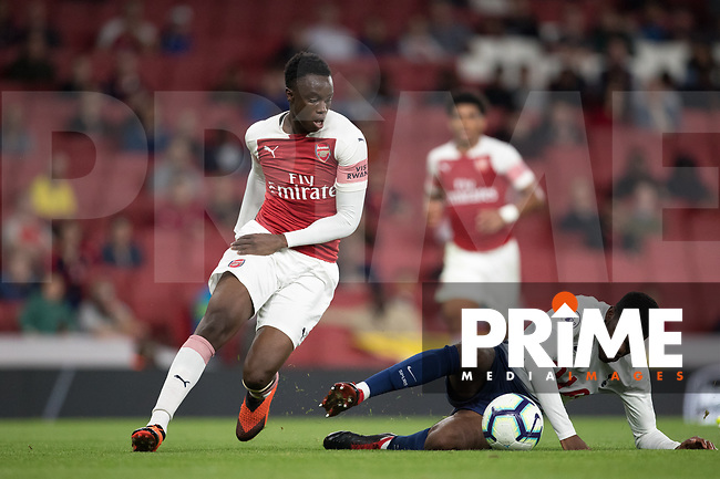 James Olayinka of Arsenal & Timothy Eyoma of Tottenham Hotspur during the Premier League 2 match between Arsenal U23 and Tottenham Hotspur U23 at the Emirates Stadium, London, England on 31 August 2018. Photo by Andy Rowland.
