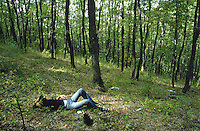 Kosovo. Pristina. Drug addiction. Heroin. Hard drug. Young man, heroin addicted, is relaxing in Germia's forest after taking his daily injection. © 2001 Didier Ruef..