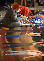 Bianca Curciaga (left) and Landon Gadberry, both sophomores at Farmington High School, paint Thursday, July 30, 2020, on an 8 foot by 24 foot mural in the Down Under at Fenix Gallery on the downtown square in Fayetteville. Students in Gretchen Wilkes' Farmington Junior High School art class partnered with local artist Octavio Logo to create the mural that will be displayed Saturday, August 22, in Farmington on the side of a building near Hwy. 62. Check out nwaonline.com/200731Daily/ and nwadg.com/photos for a photo gallery.<br /> (NWA Democrat-Gazette/David Gottschalk)