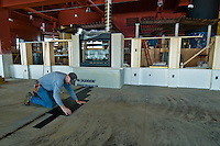 A worker installs flooring in the refurbished Bel Lago restaurant on Hoover Reservoir. The restaurant opened two years ago as the Hoover Grill and is being rebuilt as an Italian eaterie. Photo Copyright Gary Gardiner. Not be used without written permission detailing exact usage.
